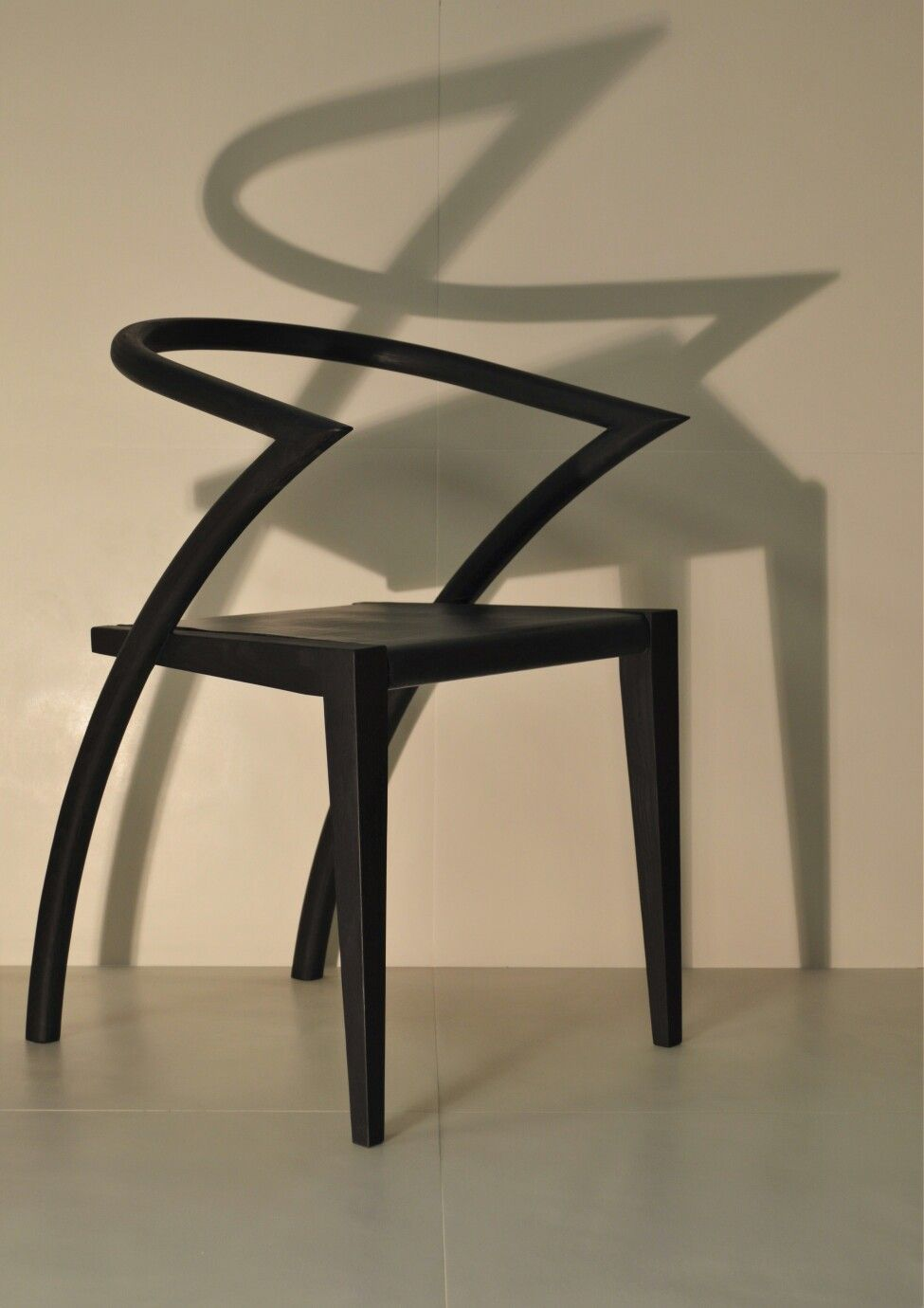 Asia Chair, in elegant black, with leather, ready for the best dinner parties.