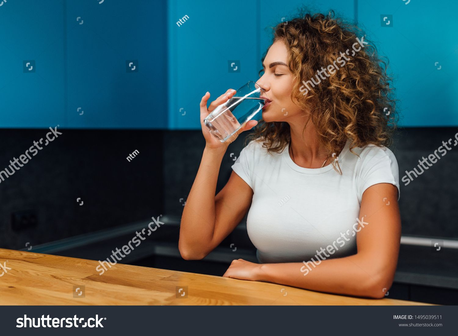 Beautiful blonde happy woman sitting with water drinks and health food at home. Vegan meal and detox concept. #Sponsored , #Aff, #sitting#water#drinks#woman