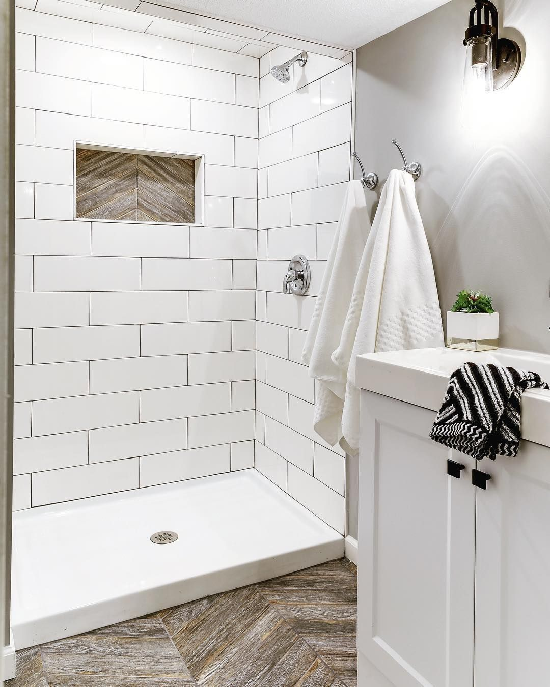 A White Shower Means Not A Speck Of Dirt Mold Or Grime Can Hide From You Which Makes Spotting What Bathrooms Remodel Small Bathroom White Bathroom Tiles