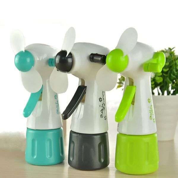 Mini Portable Handheld Cooling Water Spray Mist Fan Spray Bottle: This  Little Fan Will Be