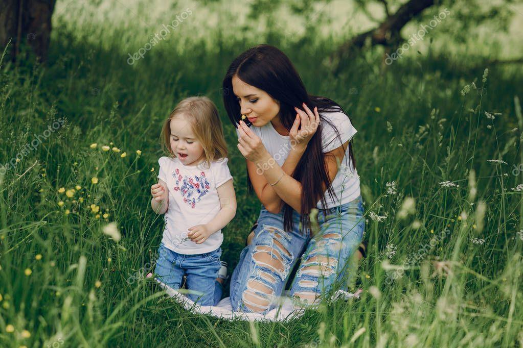 Child near tree with mom stock photo ad tree