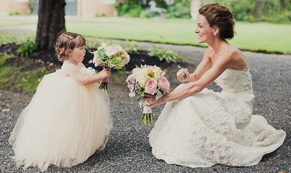 Why not have your flower girl in something other than atraditional flower girl dress? Have you thought about a ruffled skirt for your fl...