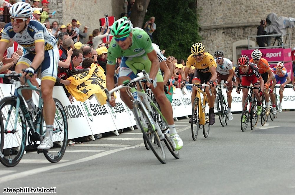 2012 tour-de-france photos stage-03.  Peter Sagan jumps around a Vasconsoleil racer to take the win.