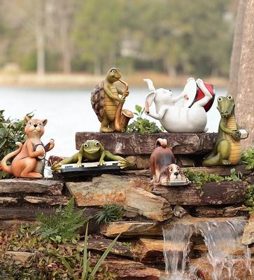 """Our fun Animal Band Resin Garden Statues are ready to entertain you and your guests. Tuning up their instruments are Harmonica Dog, Saxophone Turtle, Accordion Alligator, Banjo Cat, Drummer Rabbit, and Piano Frog. Weather-durable resin. A Wind & Weather Exclusive.· Animal Band Resin Garden Statues· Ready to entertain you and your guests· Weather-durable resinSizeDog 8-1/2""""W x 7""""HTurtle 7-1/2""""W x 10-1/2""""HAlligator 8""""W x 12""""HCat 8""""W x 11""""H Rabbit 12""""L x 9""""HFrog 12-1/2""""W x 8""""H"""