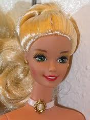 How to wash barbie (and other dolls) hair:  http://www.ehow.com/how_6399578_wash-barbie-hair.html