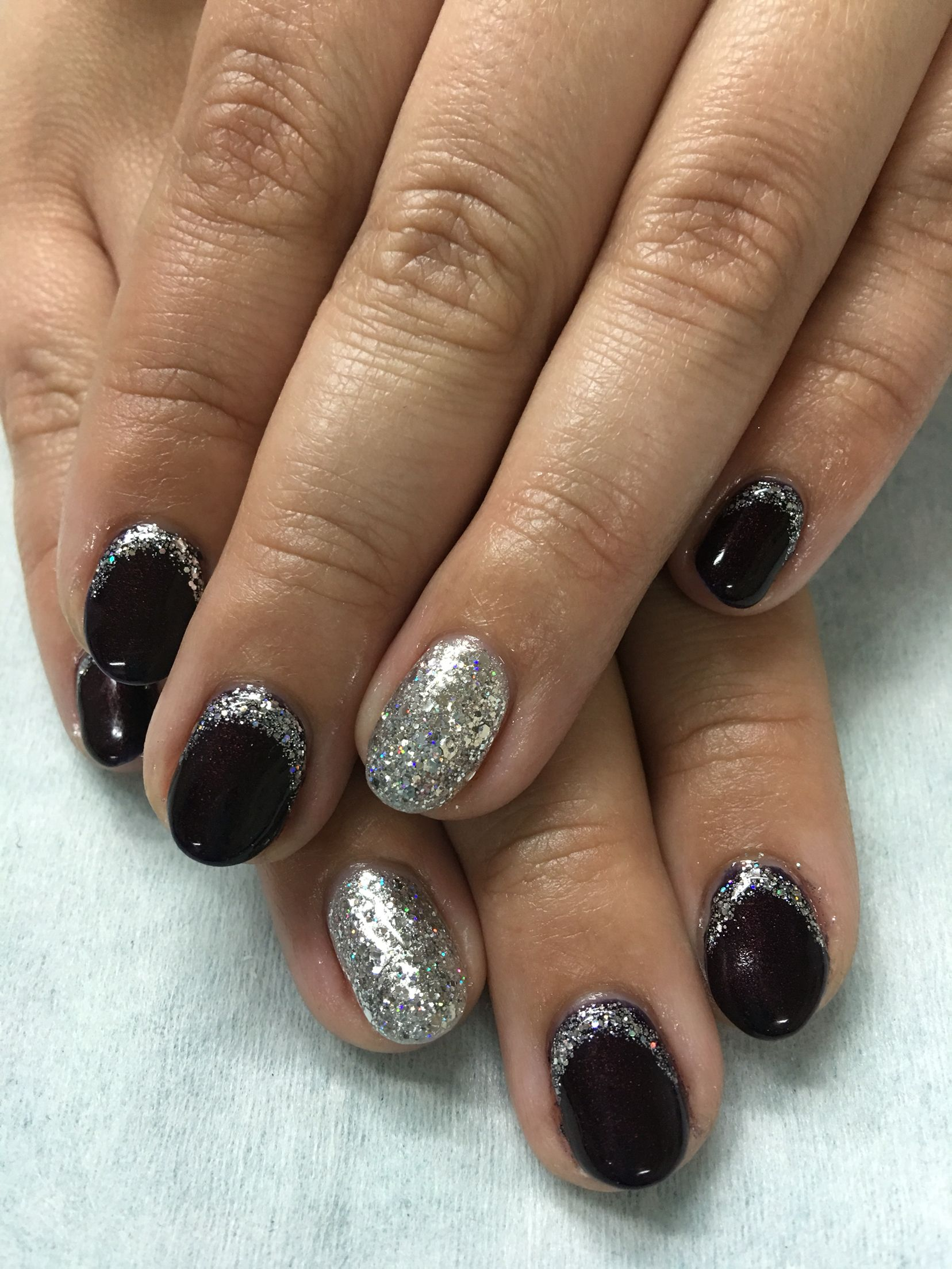 Black Cherry (OPI Every Month is Oktoberfest) and silver glitter ...