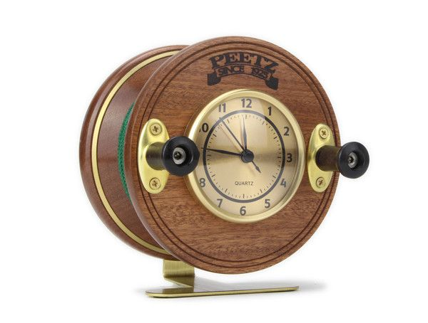 PEETZ™ Fishing Reel Desk Clock A great gift for the fisherman in your life...  The PEETZ™ Fishing Reel Desk Clock is handmade in Canada by true craftsmen*. It is based on the timeless design of the legendary PEETZ™ Classic mahogany and brass fishing reels. It would make a nice addition to any office, home or boat or a great gift for the fishing fanatic in your life.