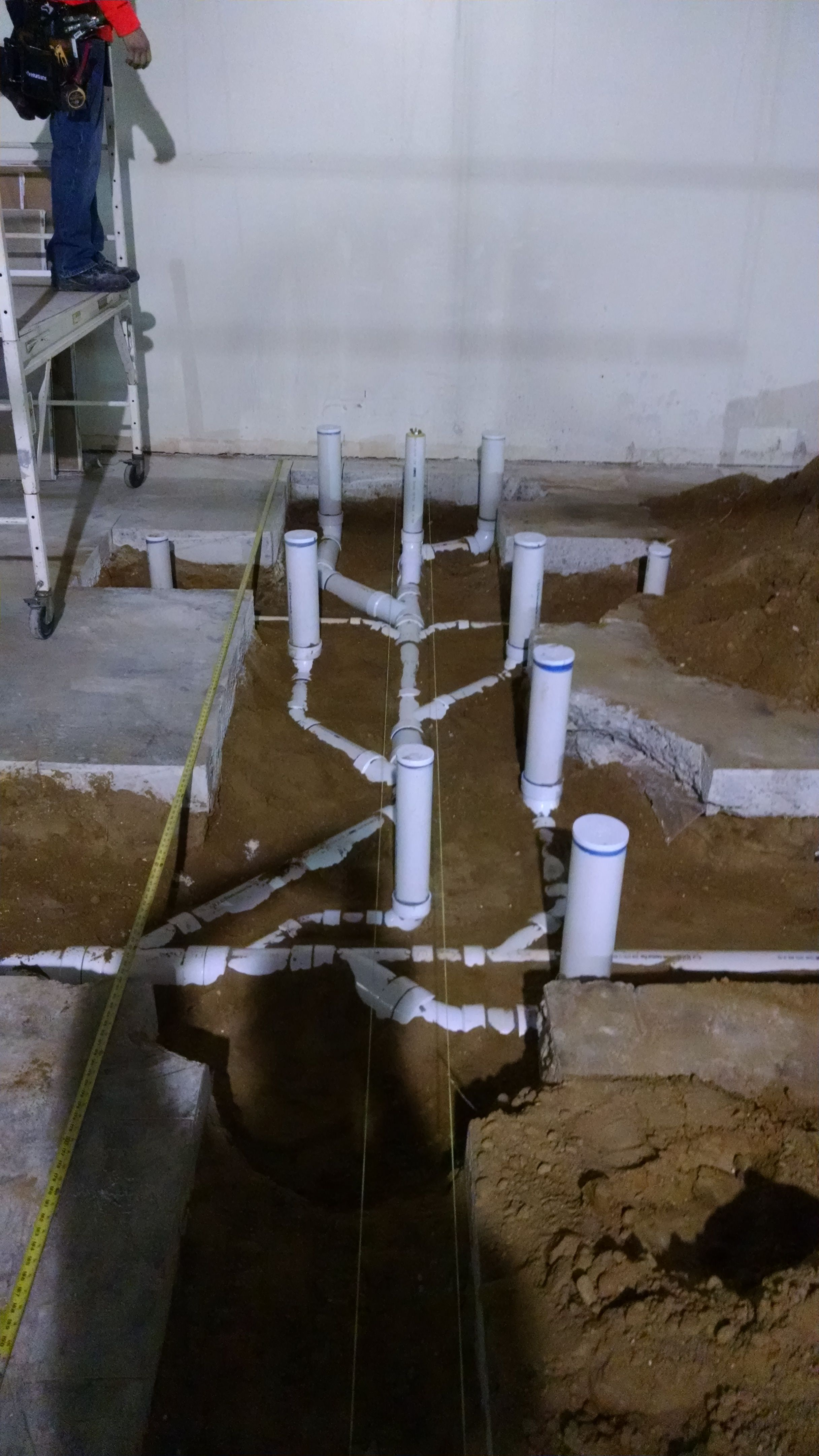 Underground toilet drains for back to back restrooms  | PIPE WRENCH