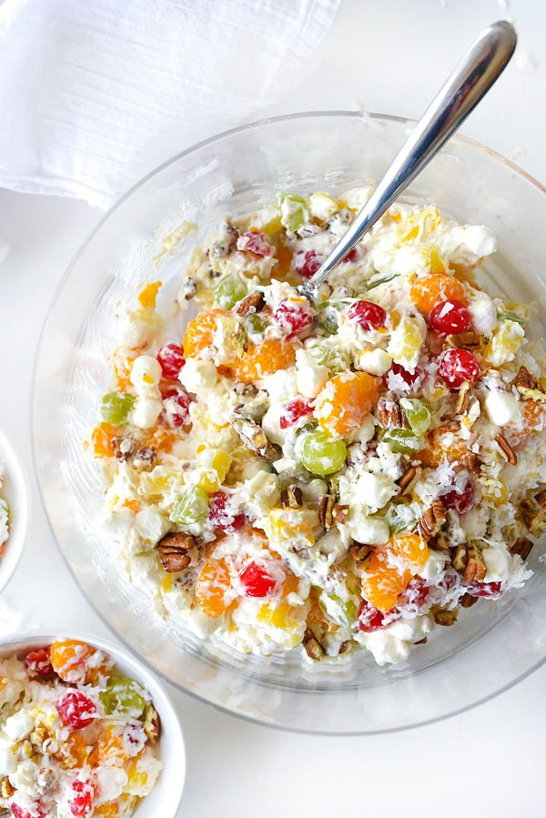 This fruit salad is one of my favorite family holiday recipes because nobody can pass up it's tropical fruit and marshmallows bathed in the tangy cream.