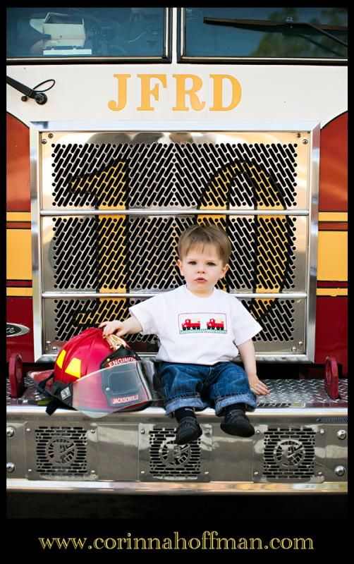 www.corinnahoffman.com Cute photo of a baby boy on the front of a fire truck in Jacksonville, Florida