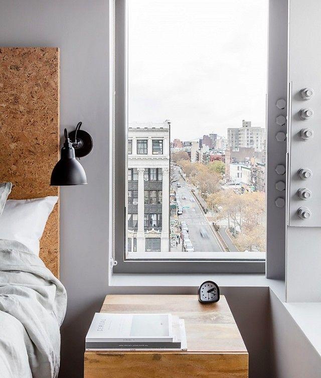 Minimalist Bedroom With Gray Walls And Cork Board Headboard
