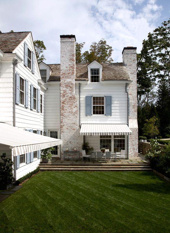 White Washed Brick Cedar Shake Roof Blue Stone Patio