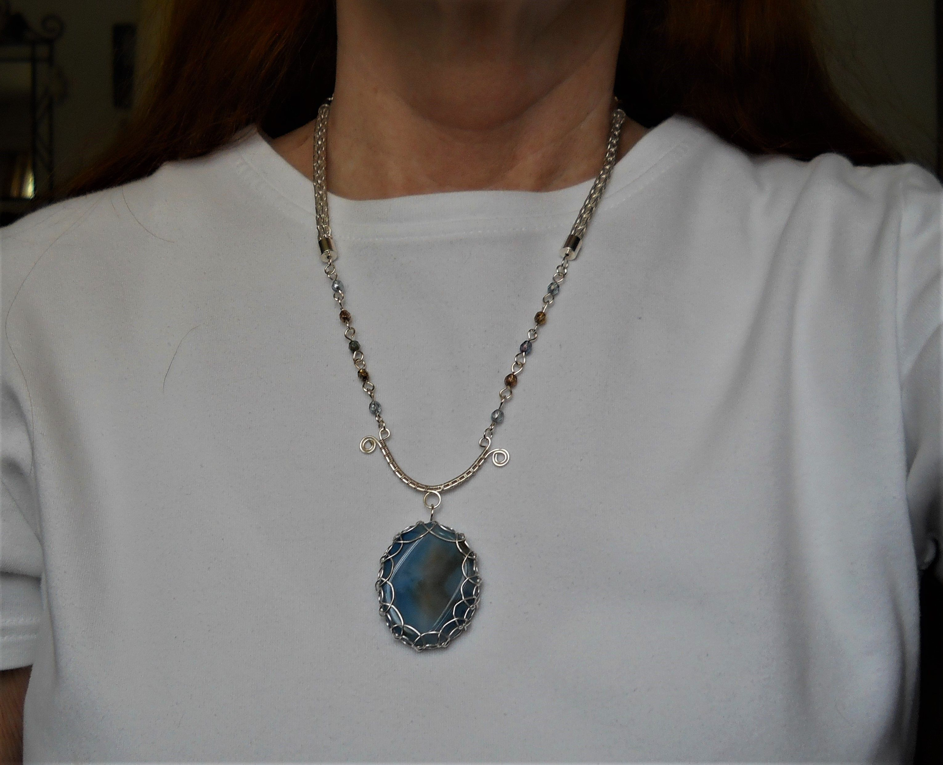 Blue agate with blue and topaz crystals with silver Viking weave sections