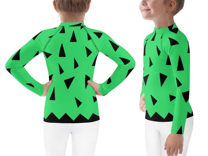 Pebbles Costume Halloween Kids Leggings Cosplay Rash Guard Shirt Cave Baby The Flintstones Teens Surfing Tee Birthday Gift Character Outfit #pebblescostume #Pebbles #cave #baby and The #Flintstones inspired #kids & #youth costume # Green top with black triangles and #blue #leggings. #Athletic #cosplay outfit for children. #Toddler and teens full length leggings, rash guard shirts, and t-shirt. Great for #Cosplay, #Halloween, themed events, conventions, birthday parties, parks visits, sports, wat #pebblescostume