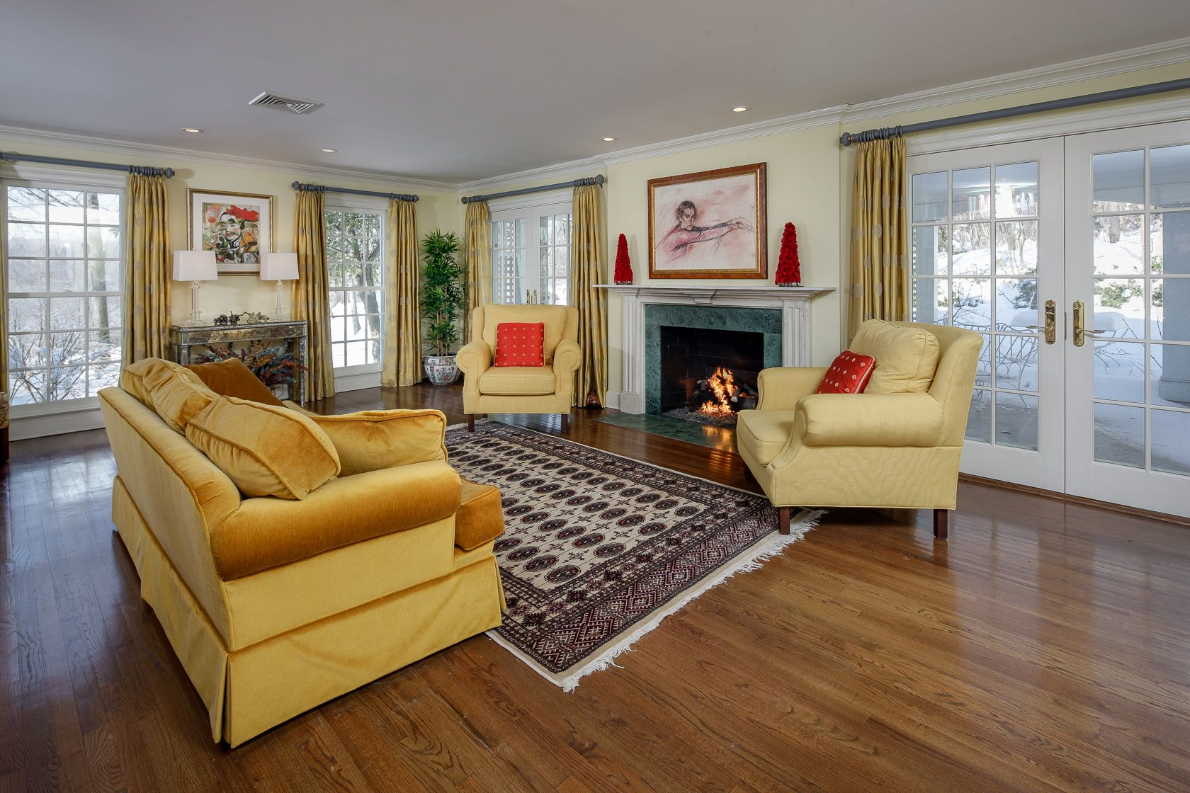 The Large Front To Back Living Room 17 X 24 Marries 3 Sides Of The Home And Features A Gas Burning Fireplace With M Wall Bookshelves Home Double French Doors