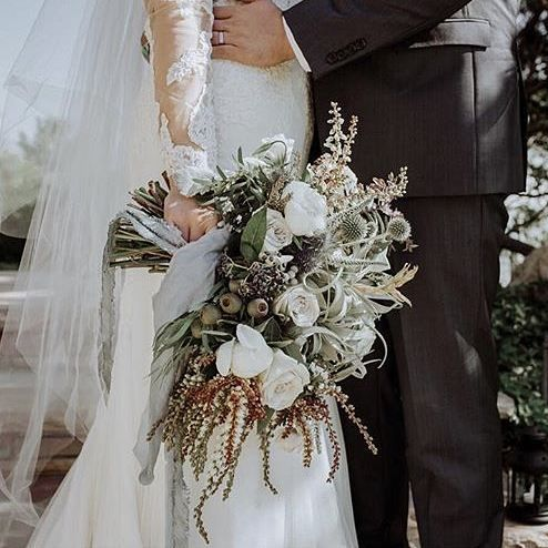 If you're not a fan of small bouquet, you will love this one from @thepottedpansy! Earthy, luscious, and exquisite at the same time! Hands up if you want something like this too!  Bouquet @thepottedpansy / Couple @katiebowoman & @Jules_juggin / Event Planning & Design @sageandthistleevents / Gown @annebarge from @altamodabridal / Ring @catbirdnyc / Veil @tonifederici / Photography @emmavidmarphoto as featured on @rockymtnbride