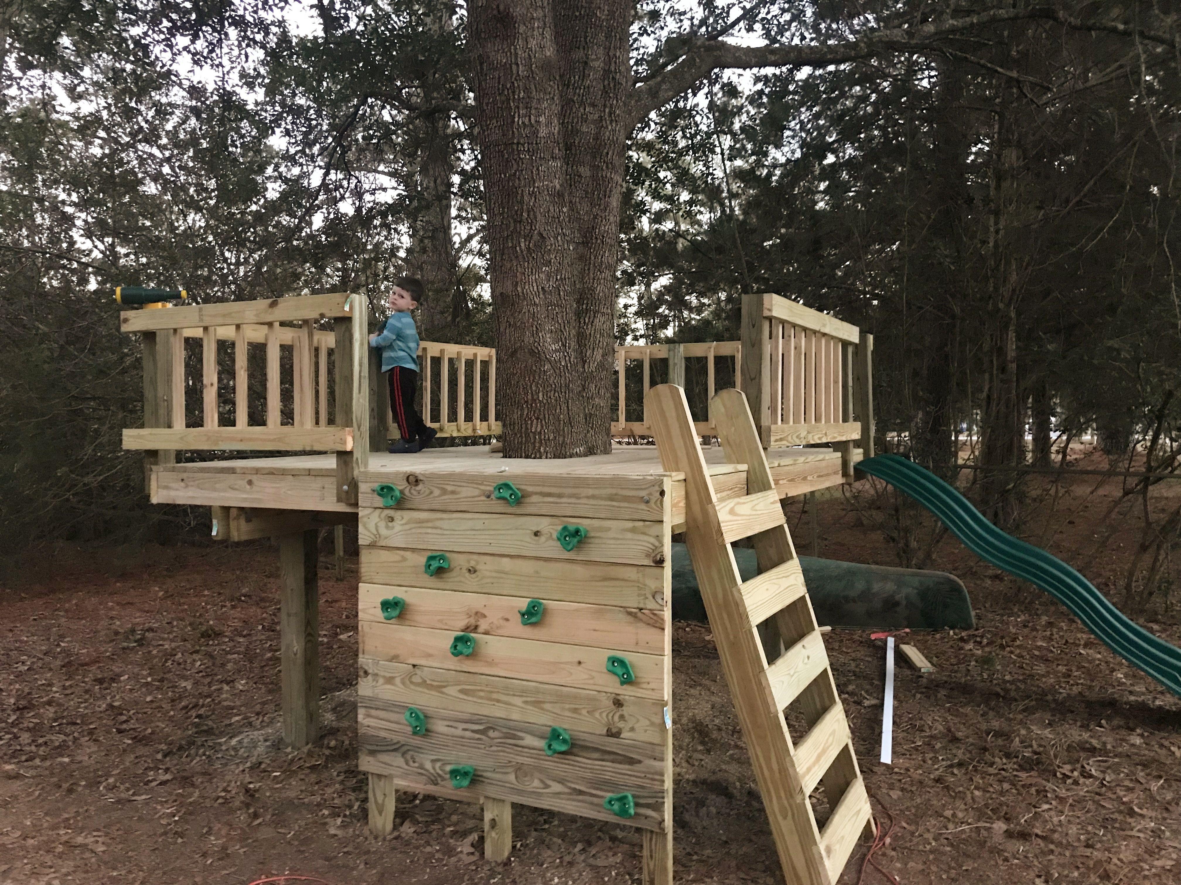Diy tree fort kids rock wall tree house railing play
