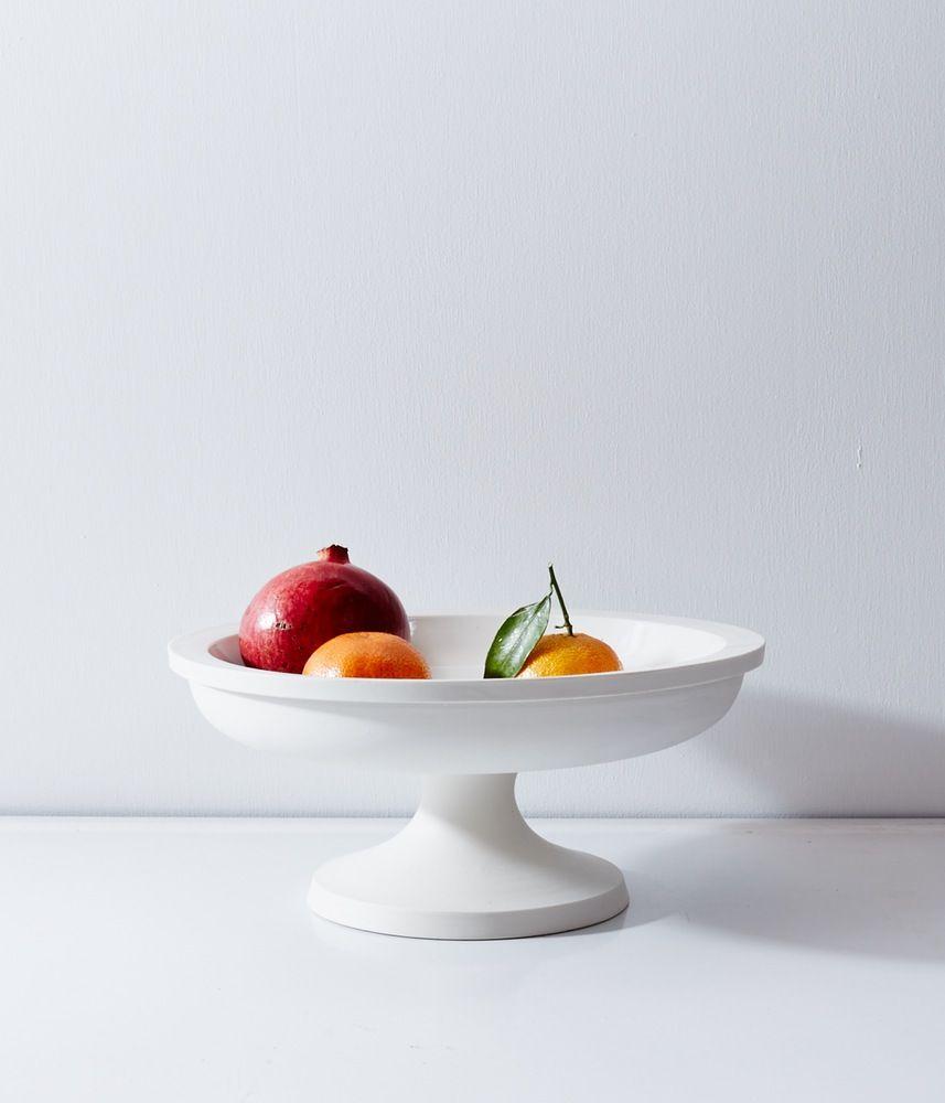 "large porcelain fruit stand; heavy white porcelain; glazed interior, unglazed exterior  beautiful shape, classic utilitarian feel; handmade by john julian design, england; 12.5""x5.25"", $520"