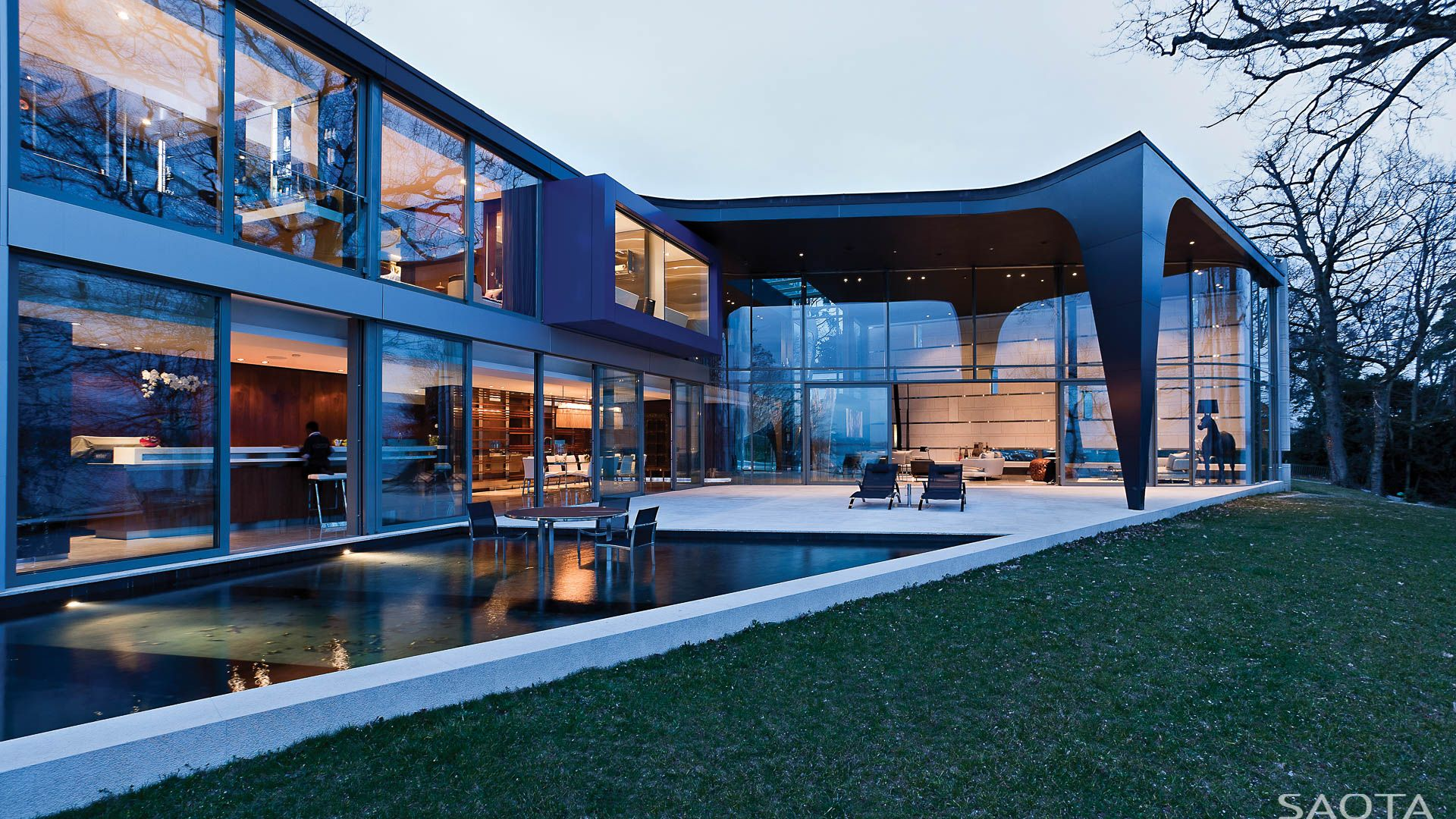 Ch lake house a contemporary residence and office guest annex on lake geneva switzerland powerful sculptural forms and lines and the use of