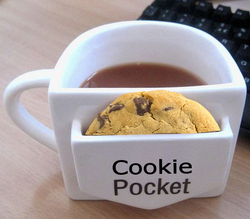 """I laughed when I saw this funny """"flat-edged"""" coffee mug. It's not the shape that got me but the cookie pocket. I love my cookies and this would be awesome even though I'd always be eating the cookie leaving it empty all the time."""