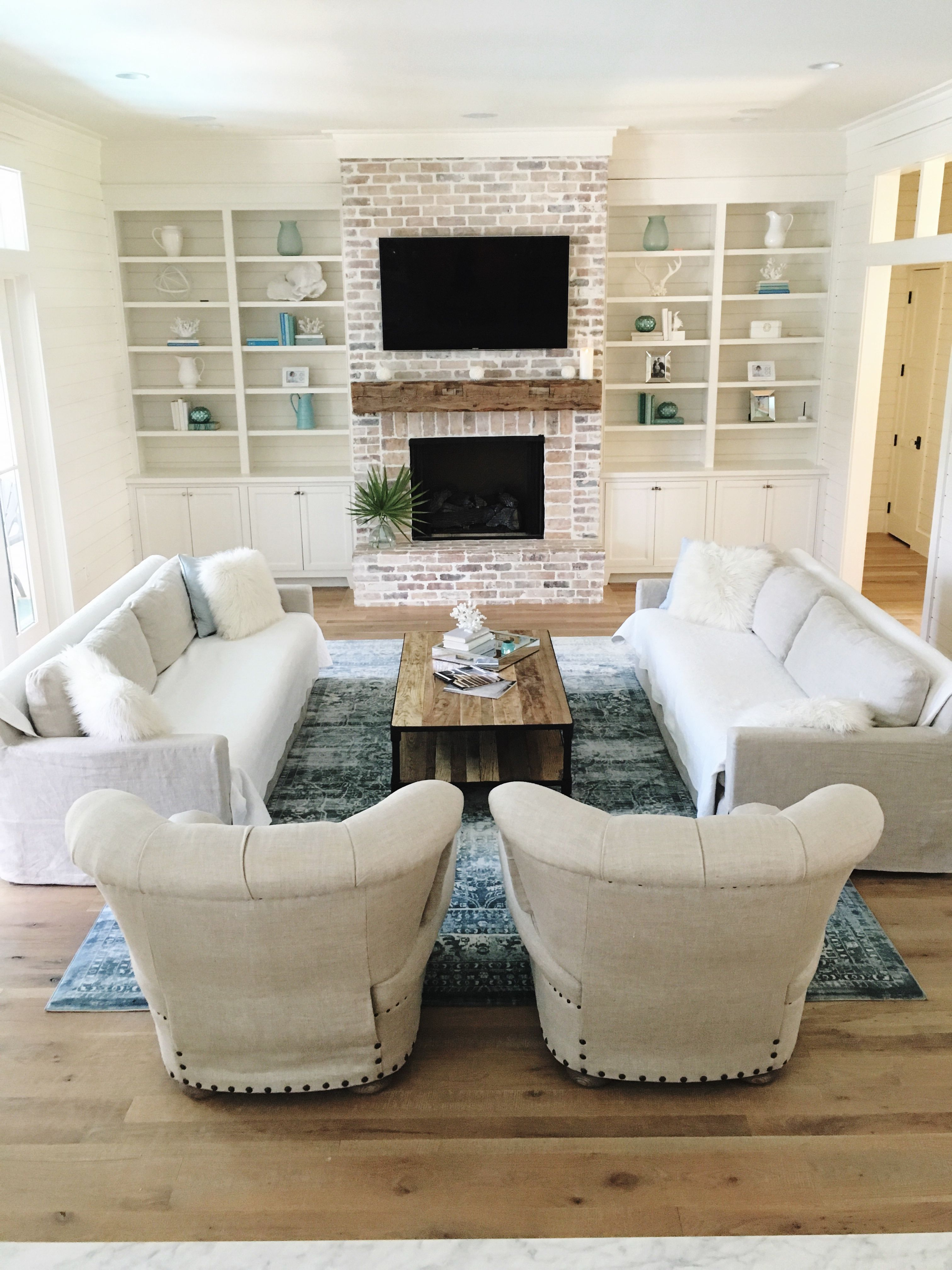 Coastal Farmhouse living room. White washed brick, oak