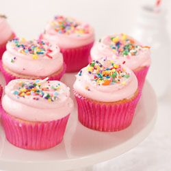 The fluffiest vanilla strawberry cupcakes with a whipped frosting and plenty of sprinkles.  #foodgawker
