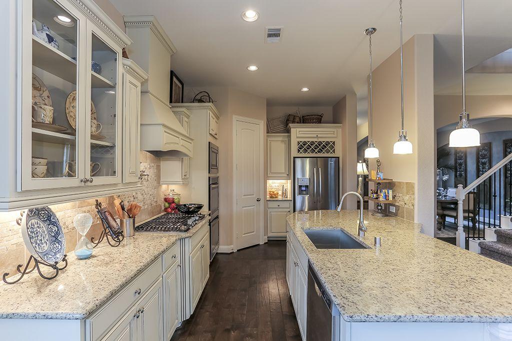 gehan homes kitchen glass cabinets light granite countertops