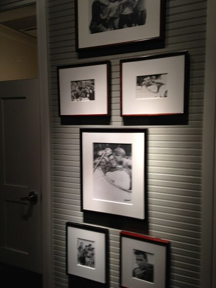 Framed black and white photos with dramatic lighting for Abercrombie interior design and decoration