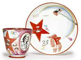 A SOVIET PROPAGANDA TEACUP AND SAUCER IMPERIAL PORCELAIN FACTORY, WITH LATER BLUE OVERGLAZE STATE PORCELAIN FACTORY MARK OF HAMMER, SICKLE AND COG, DATED 1922 14k