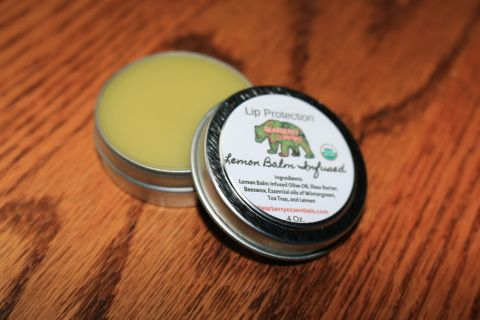 Lip Protection $4.00  This 100% organic lip balm is formulated to protect and relieve lips from the sun and outdoor adventures.  Lemon balm infused oil is combined with the essential oils of wintergreen, tea tree, and lemon to bring you this simple but effective lip balm.