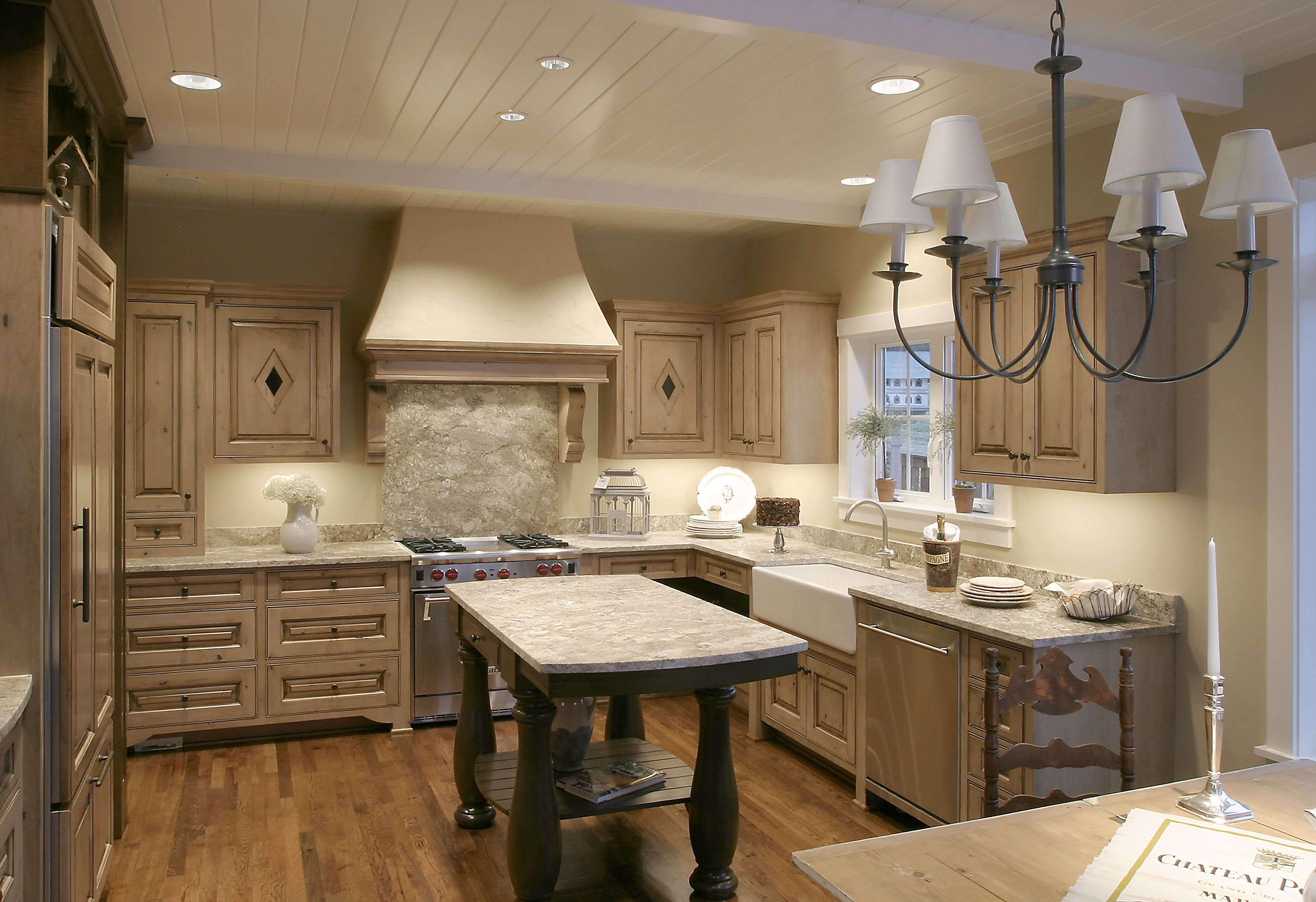 Glazed knotty alder cabinetry topped with honed granite Hickory