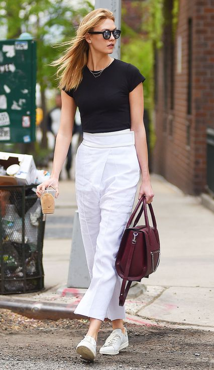 16 Times Karlie Kloss Killed It in Flats | People - in a Lavender Hill tee, Céline cropped trousers, Adidas sneakers with a burgundy bag and Illesteva sunglasses.