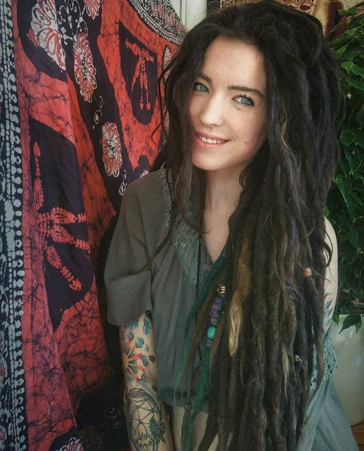 dreads! well taken care of. healthy looking! dark long hair. wild