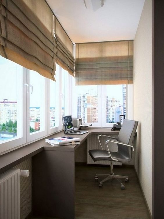 manly balcony home office with a windowsill as a desk, a comfy chair and shutters #smallbalconyfurniture