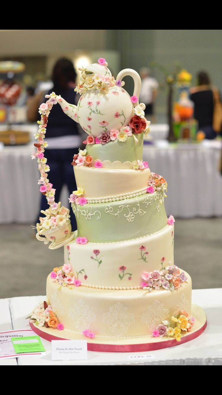 For Disney wedding use Mrs Potts & Chip from Beauty and