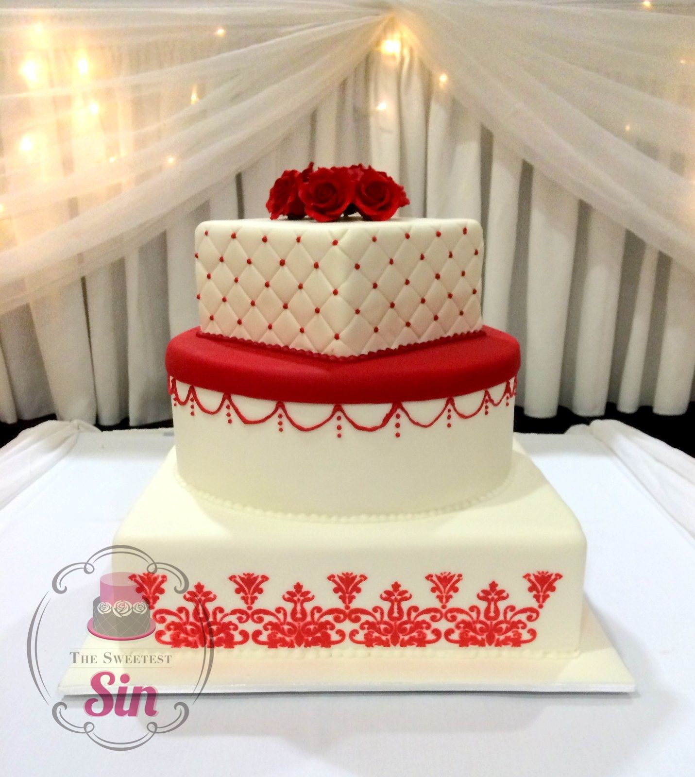 Red and white tier wedding cake by the sweetest sin nothing but