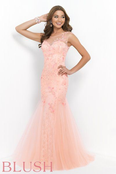 Blush Prom Dress Style 9960. Coral Pink all lace low back sweetheart sheath is overlaid with a bandeau style mesh shell detailed with a floral pattern of color matching beads and clear crystals. The skirt is flared with gussets of tulle that flow into a sweeping train. This gown is the happy medium between modest and sexy. Come see us at Rubie&Jane in Lufkin,TX for Prom 2015!