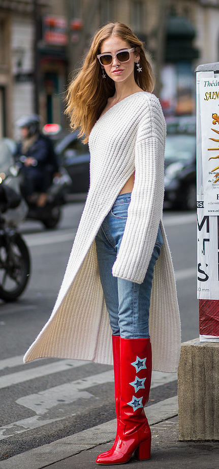 A long knit sweater and bold red boots