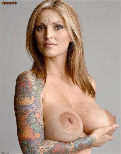 Big boobs tattooed milf