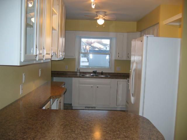 3b  Small kitchen, now there is plenty of storage, counter surface and an eat-in area!