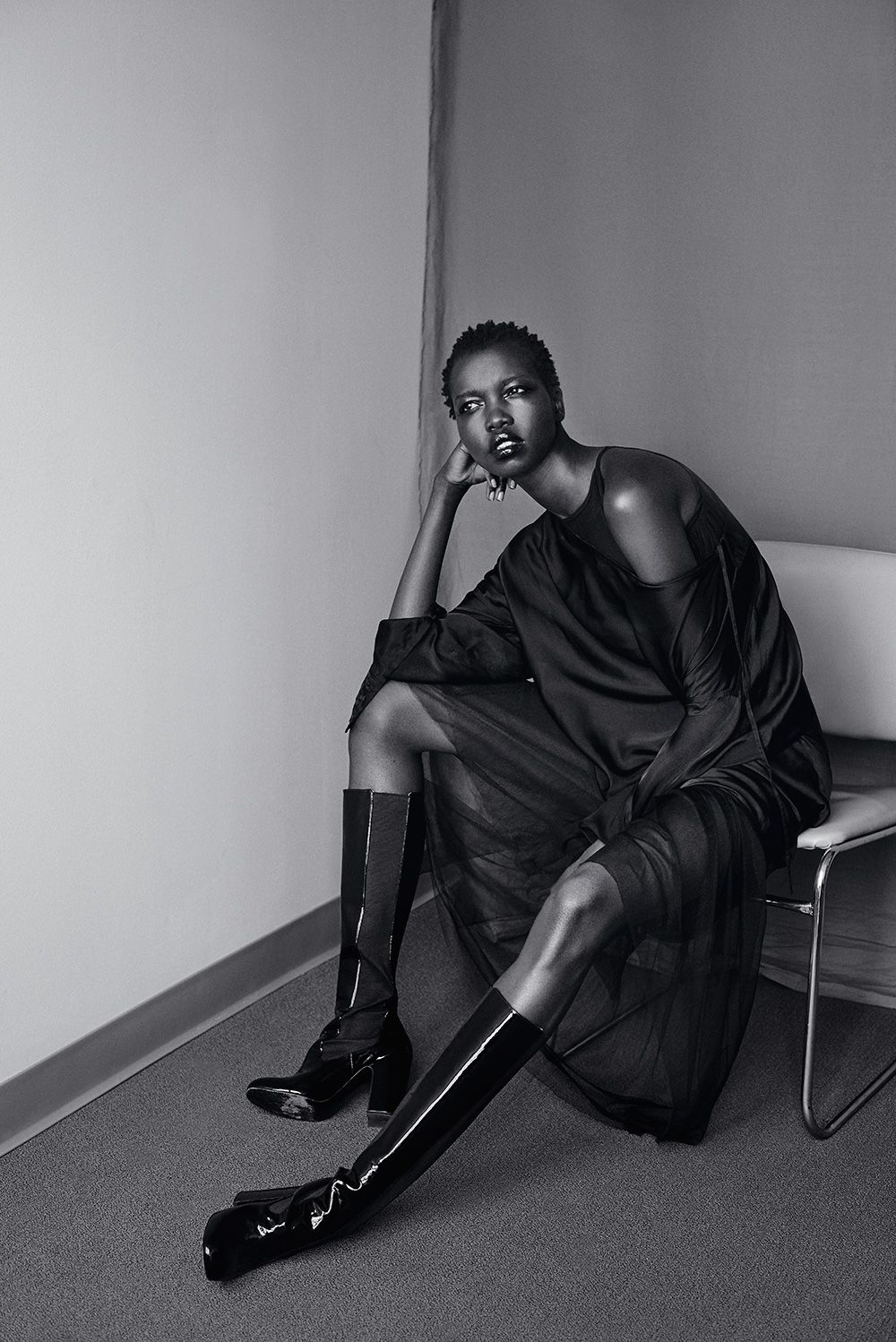 Photo of model nykhor paul in office setting image of black and white photo