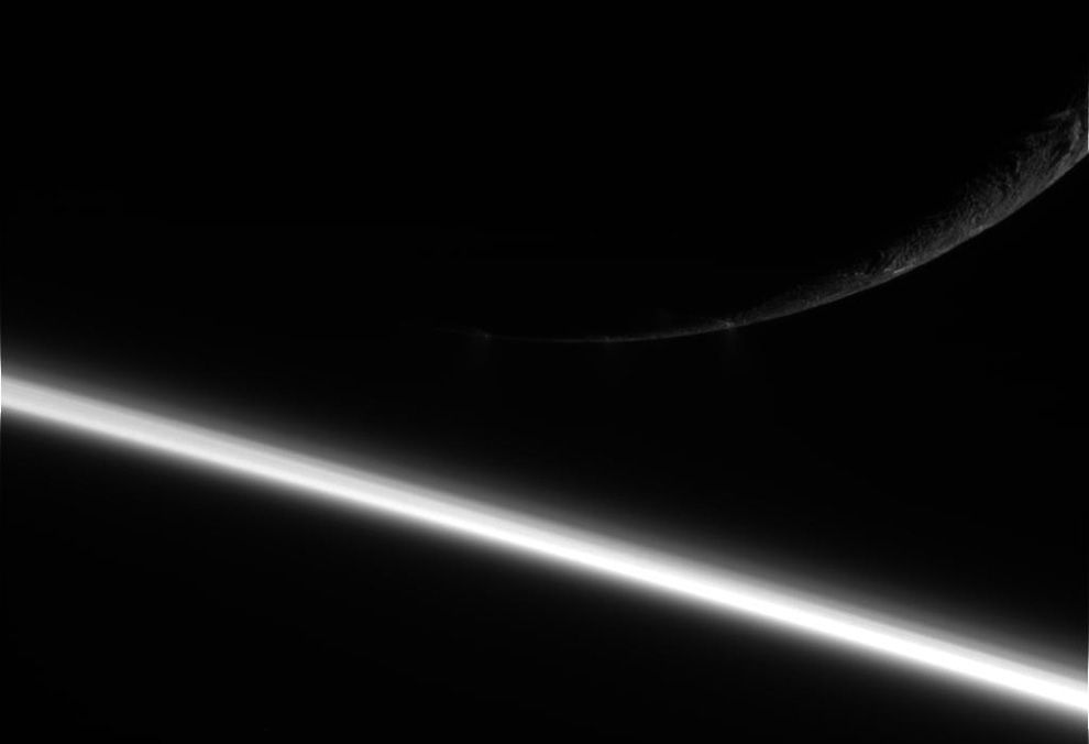 Saturn and its moon Enceladus. Picture taken spacecraft Cassini on August 13.