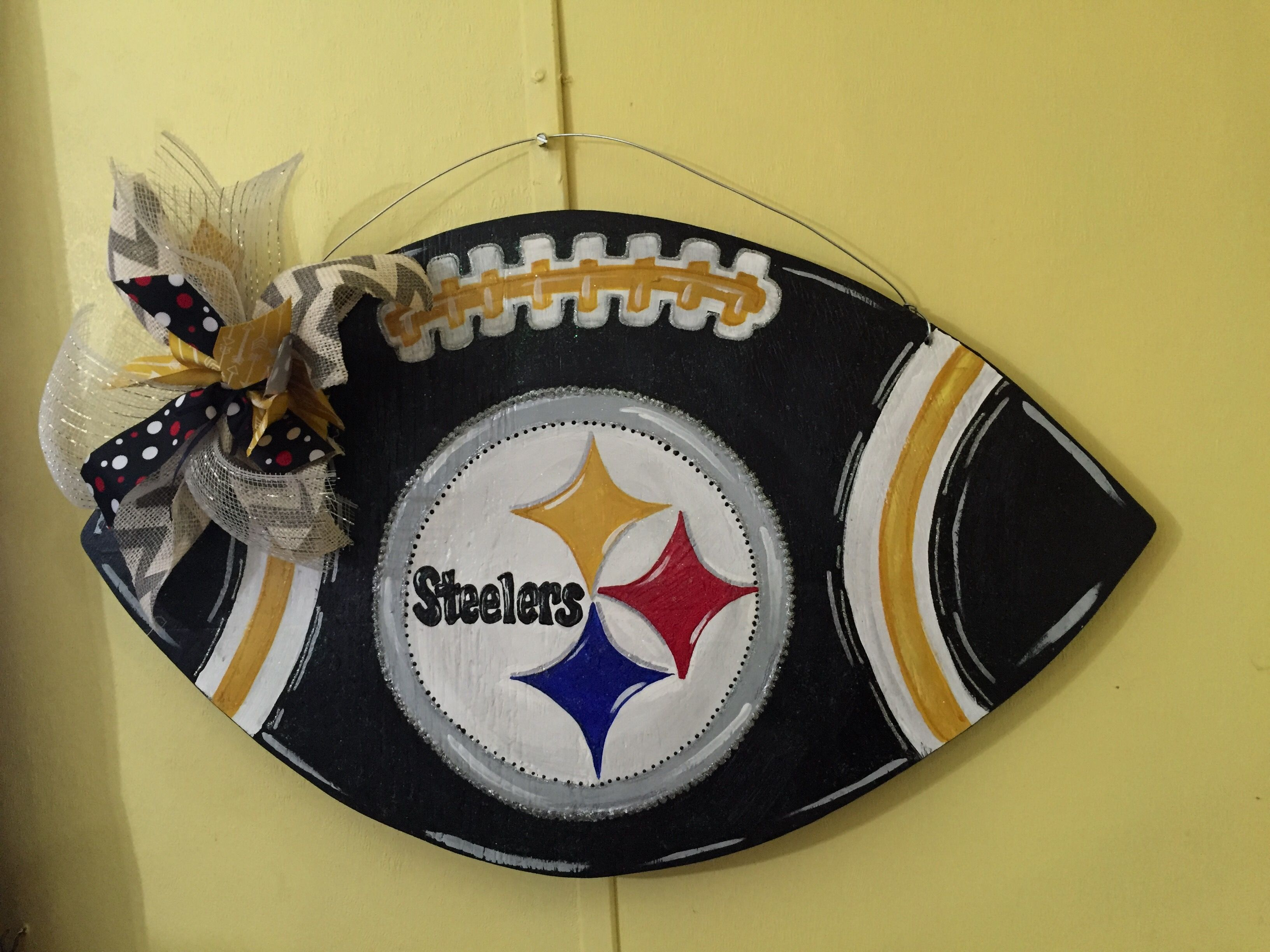 I painted this football door hanger with a Steelers theme ...