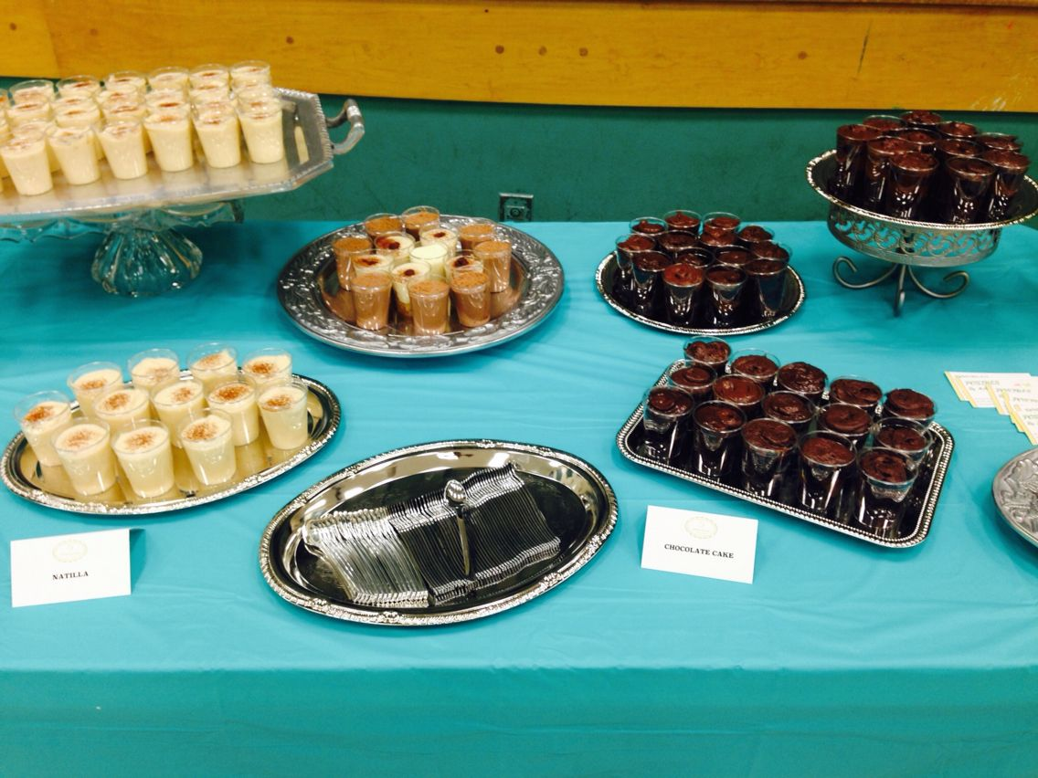 Decorated table, chocolate cake shots, Natilla shots, tres Leches ...