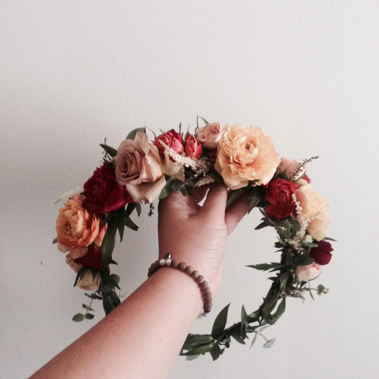 The Marcella Crown Peach And Burgundy Ranunculus Spiral Eucalyptus And Blush Spray Roses Www Thecrowncollective Co Flower Crown Wedding Crown Floral Crown