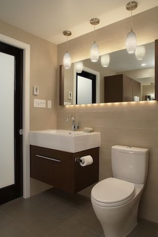 Long mirror above sink and toilet. Lighting is amazing, storage ...
