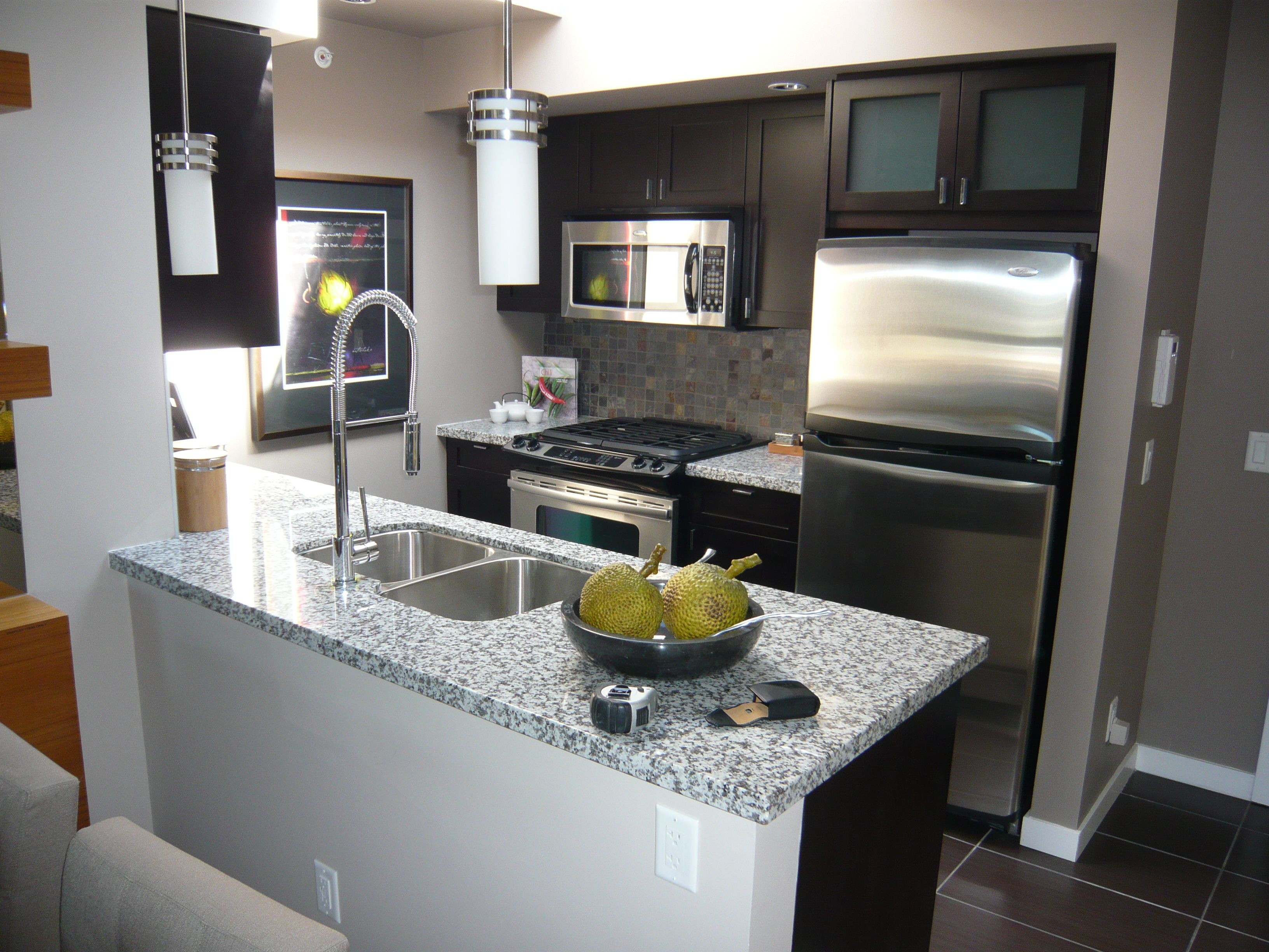 Small spaces beautiful condo kitchen home improvement for Kitchen remodels for small kitchens