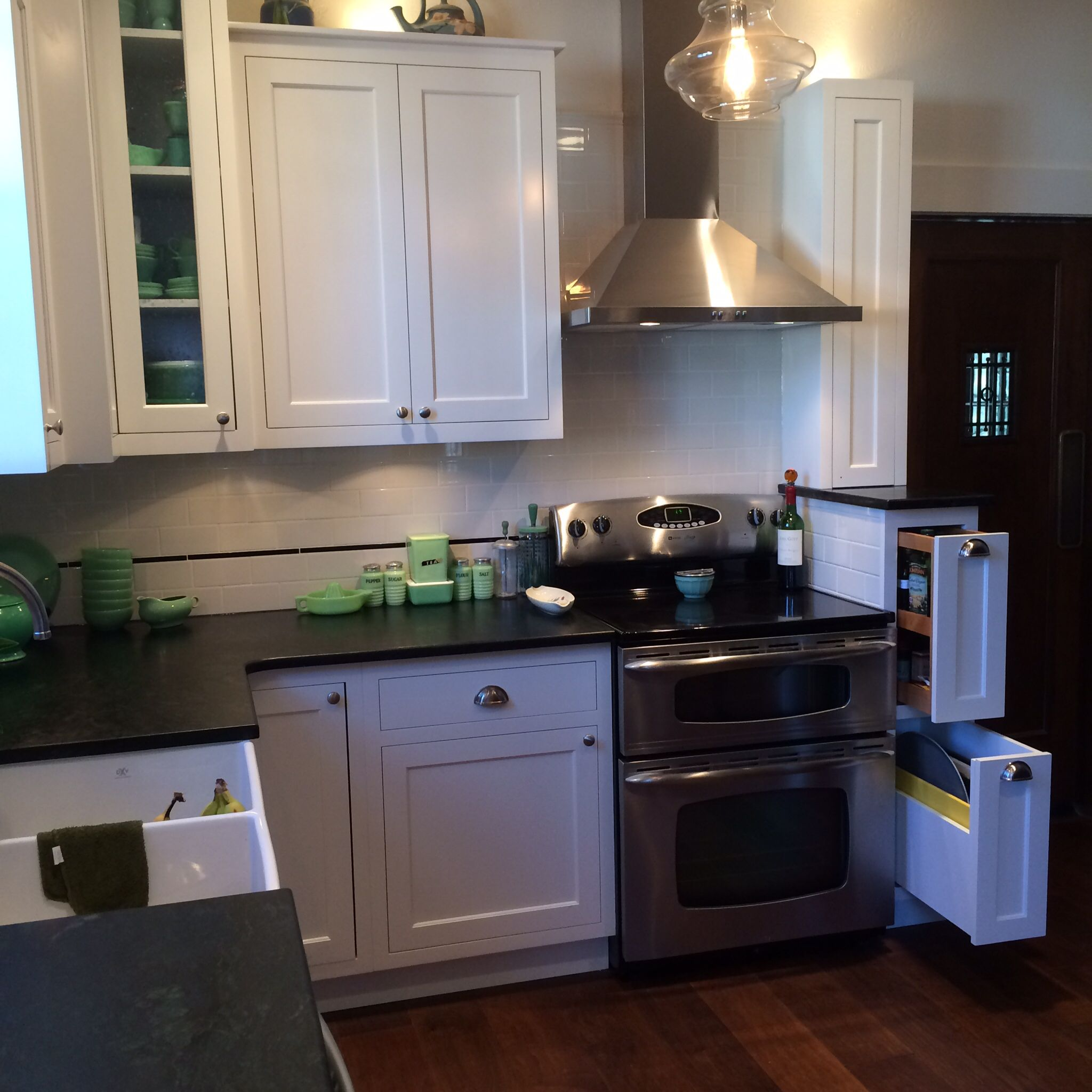 Custom white kitchen with inset cabinets, subway tile w/ glass bar liner and soapstone countertops, Caldera Design LLCC