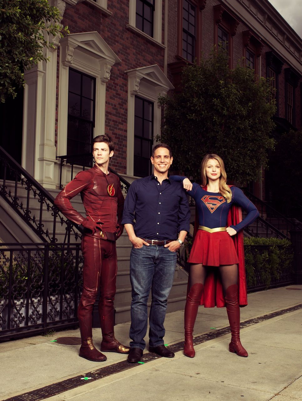 Actor Grant Gustin as The Flash/Berry Allen, producer Greg Berlanti and actress Melissa Benoist as SuperGirl/Kara Zor-El
