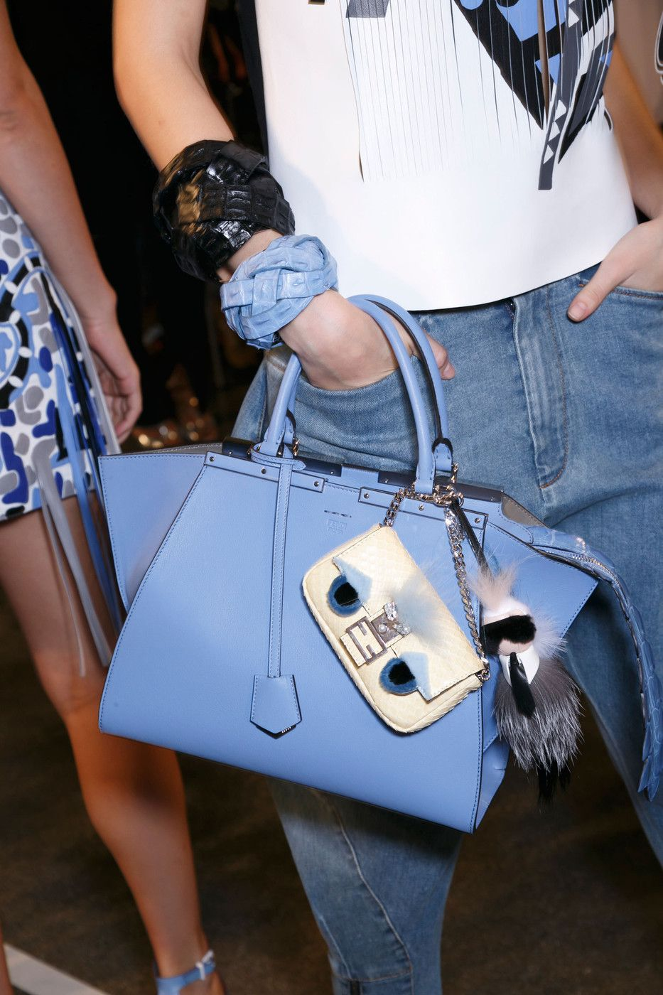 Baby blue Fendi bag with cute bag accessories // Milan Fashion Week Spring 2015